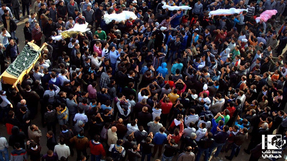 Anti-Syrian regime mourners carry the coffins of Syrian civilian who where killed by the shelling of Syrian forces loyal to president Bashar Assad, in Homs, Syria, Monday Dec. 3, 2012. (AP / Lens Yong Homsi)
