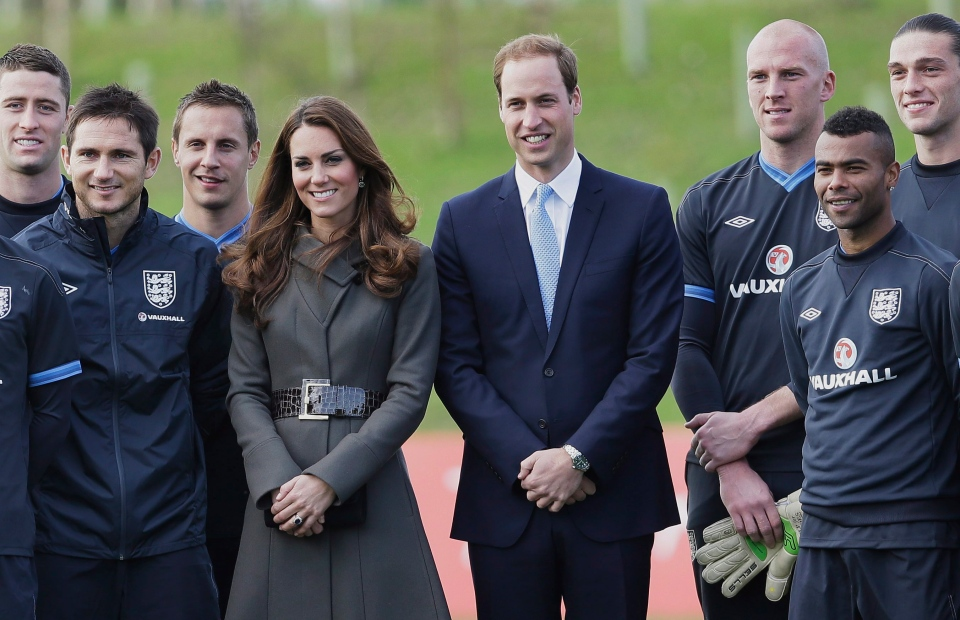 Prince William and Kate, Duchess of Cambridge stand with members of the England football squad at St George's Park near Burton Upon Trent in Staffordshire, England, Tuesday, Oct. 9, 2012. (AP / Kirsty Wigglesworth)