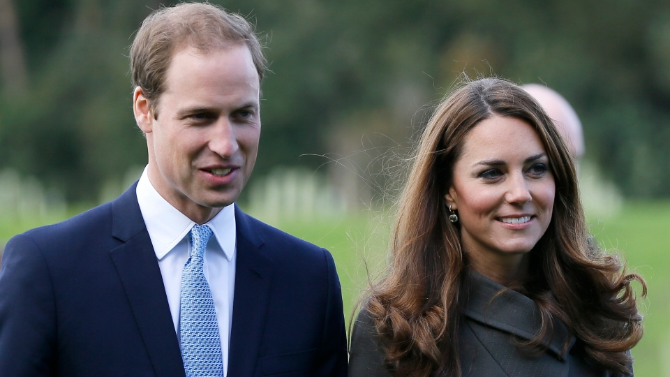 Prince William, left, and his wife Kate, the Duchess of Cambridge, visit a football training pitch at St George's Park near Burton Upon Trent in Staffordshire, England on Tuesday, Oct. 9, 2012. (AP / Kirsty Wigglesworth)