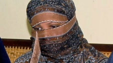 Pakistani Christian woman Asia Bibi, listens to Governor of Pakistani Punjab Province Salman Taseer, unseen, at a prison in Sheikhupura near Lahore, Pakistan, on Saturday, Nov. 20, 2010.  (AP )