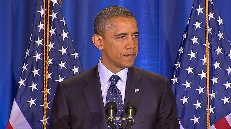 U.S. President Barack Obama warns Syria, 'The world is watching.'