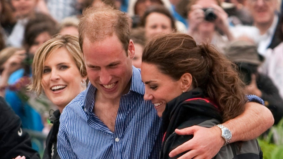 The Duke and Duchess of Cambridge hug after taking part in a dragon boat race in Dalvay, PEI Monday, July 4, 2011. (Ryan Remiorz / THE CANADIAN PRESS)