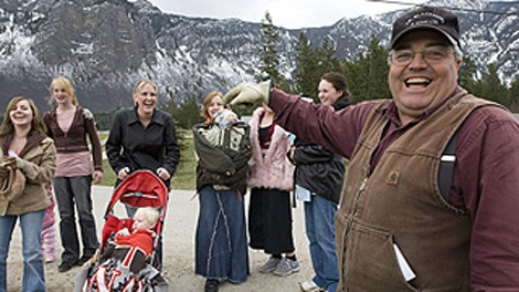 Winston Blackmore the religious leader of the polygamous community of Bountiful located near Creston, B.C. shares a laugh with six of his daughters and some of his grand children, April 21, 2008 near Creston, B.C. (THE CANADIAN PRESS/Jonathan Hayward)