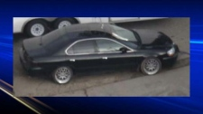 The vehicle is described as a black four-door Acur