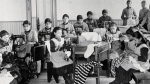 Students learn how to sew at Fort Resolution Indian Residential School (St. Joseph's Convent), in Resolution, N.W.T., in this undated image. (Library and Archives Canada)
