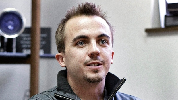 Actor Frankie Muniz, left, sits with members of the pop rock band Kingsfoil in York, Pa., on April 6, 2012. (AP Photo/The Patriot-News, Dan Gleiter)
