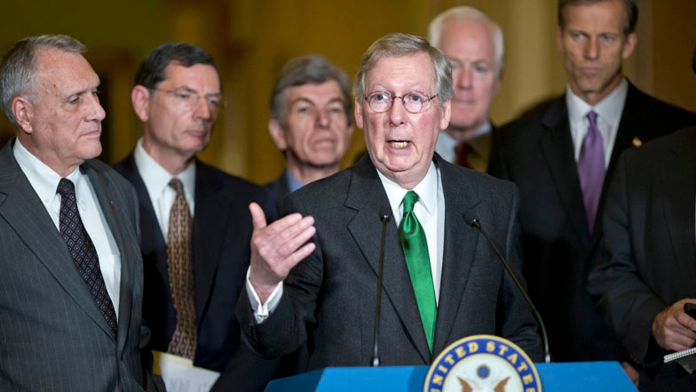 Senate Minority Leader Mitch McConnell of Ky. gestures as he speaks with reporters on Capitol Hill in Washington, Tuesday, Dec. 4, 2012. (AP / J. Scott Applewhite)