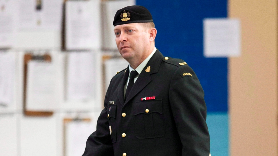 Maj. Darryl Watts arrives for court martial proceedings in Calgary on Wednesday, Nov. 14, 2012. (Larry MacDougal / THE CANADIAN PRESS)