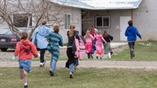 Children run back to class following a recess at Mormon Hills school in the polygamous community of Bountiful, B.C. in this April 21, 2008 photo. THE CANADIAN PRESS/Jonathan Hayward