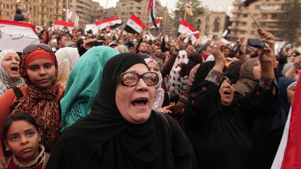 Protesters chant slogans in Tahrir Square in Cairo, Egypt, Tuesday, Dec. 4, 2012. (AP / Maya Alleruzzo)
