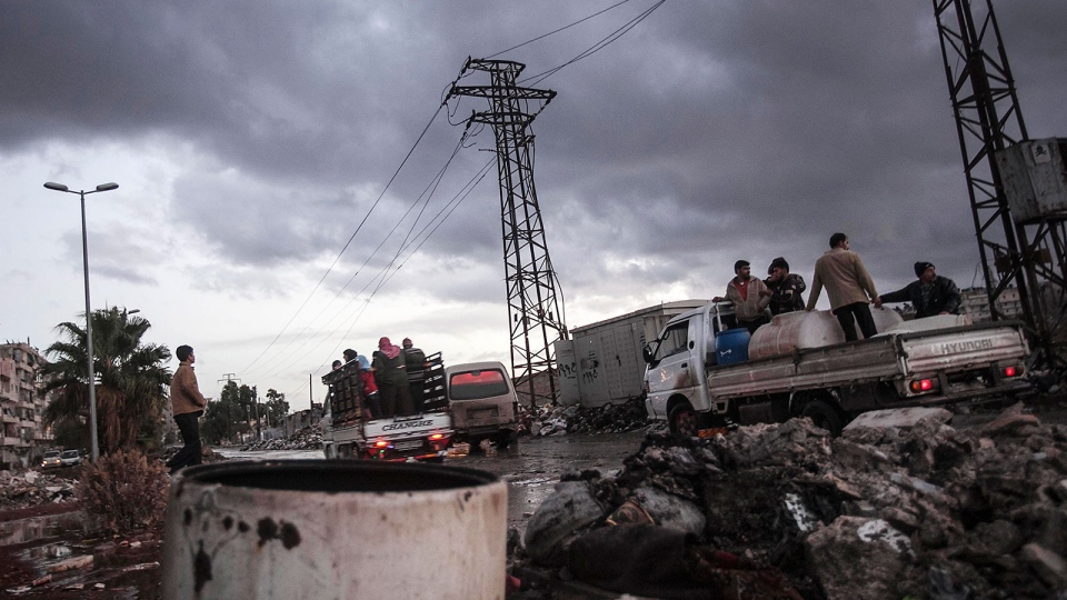 Syrians stand on trucks at a street in Aleppo, Tuesday, Dec. 4, 2012. (AP / Narciso Contreras)
