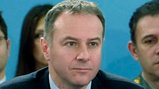 In this Dec. 14, 2006 file photo made available by NATO, Serbia's ambassador to NATO, Branislav Milinkovic, is seen during a meeting at NATO headquarters in Brussels, Belgium. (AP Photo/NATO, file)