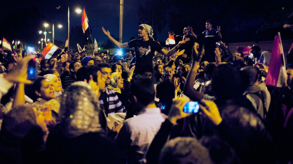 Egyptian protesters chant anti Muslim Brotherhood slogans during a demonstration in front of the presidential palace in Cairo, Egypt, Tuesday, Dec. 4, 2012. (AP / Nasser Nasser)