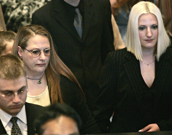 Chuck Cadman's wife Dona (left) and daughter Jodi Cadman-Miller leave the church following Cadman's memorial service in Surrey, B.C. Saturday July 16, 2005. (Chuck Stoody / THE CANADIAN PRESS)
