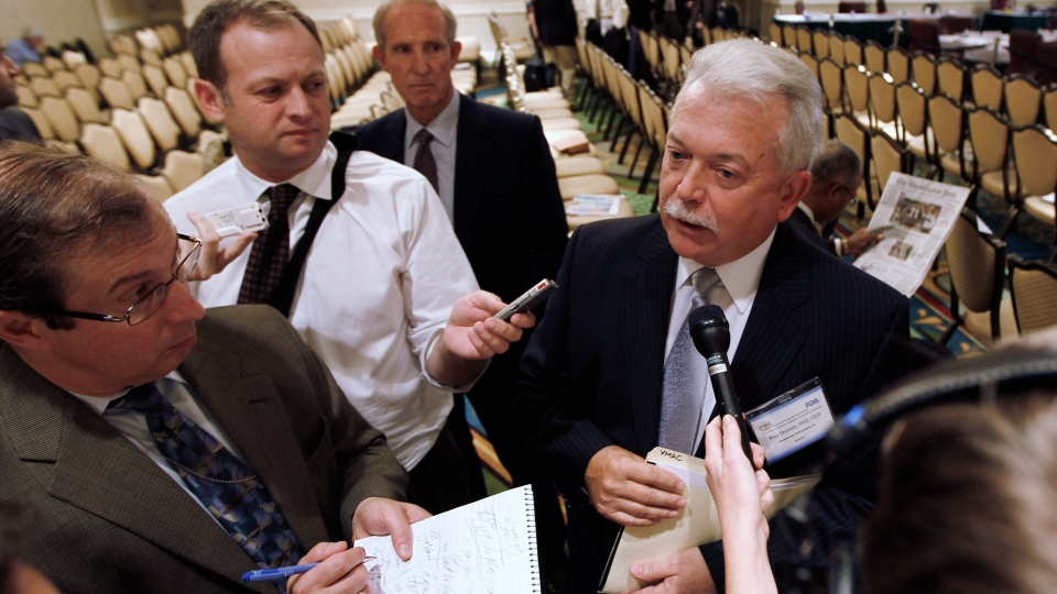 Ron Stotish, chief executive officer of AquaBounty, the company that applied with the Food and Drug Administration to market genetically modified salmon, speaks to reporters during a break at an FDA advisory committee hearing in Rockville, Md., Monday, Sept. 20, 2010. (AP Photo/Charles Dharapak)