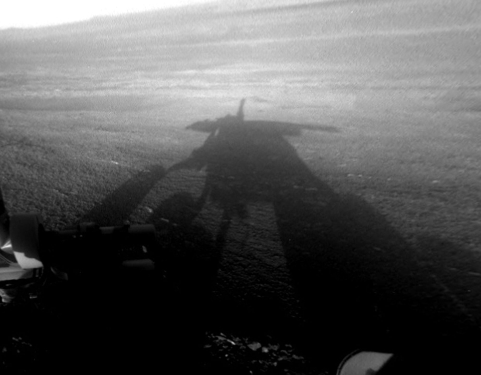 This image provided by NASA shows a shadow self-portrait taken by NASA's Opportunity rover on the Martian surface. (AP Photo/ NASA)