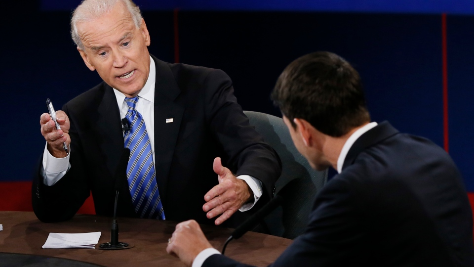 This Oct. 11, 2012 file photo shows Vice President Joe Biden, left, and Republican vice presidential nominee Rep. Paul Ryan of Wisconsin participating in the vice presidential debate at Centre College in Danville, Ky. (AP Photo/Pool-Rick Wilking, file)