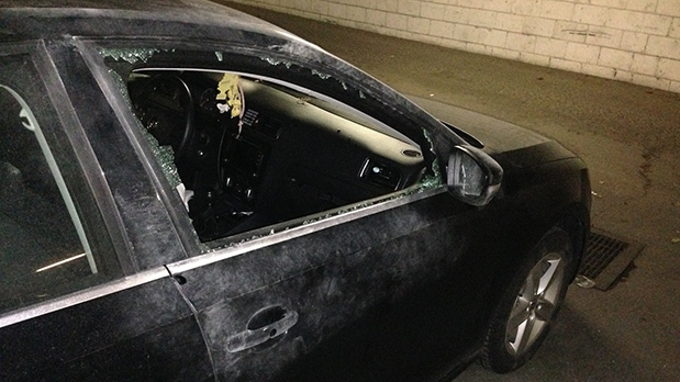 Parked car with smashed window