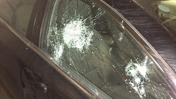 A parked car with a smashed window is shown after a break-in on Dec. 5, 2012. (Tom Stefanac / CP24)