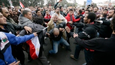 Egyptian protesters clash over Morsi's decrees