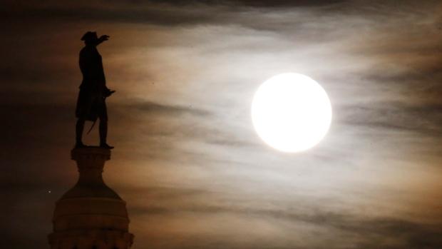 Moon shines over the Trenton Battle Monument.