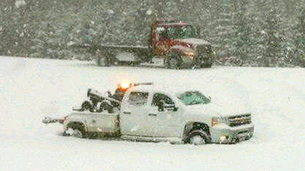 A tow truck can be seen after sliding off the road near Stony Plain on Wednesday, December 5