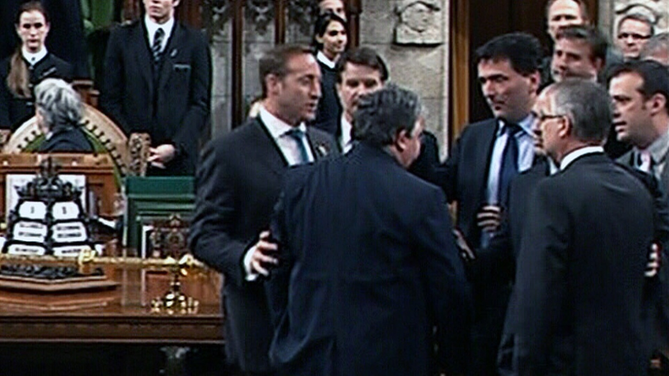 MPs scuffle on the floor of the House of Commons