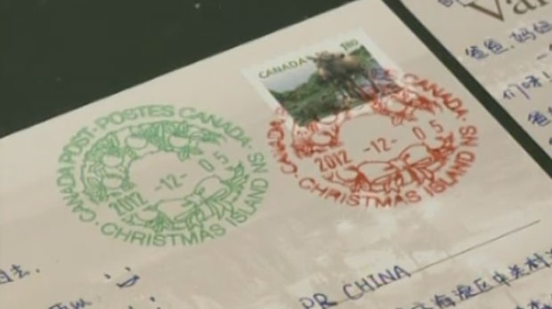 Holiday greetings passing through the Christmas Island post office receive a festive postmark during the Christmas season.