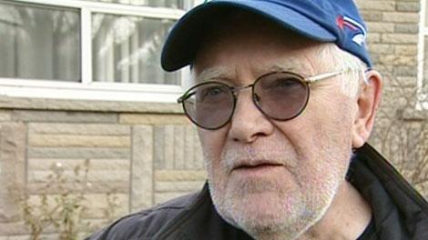Retiree Martin Bjarnason discusses his hydro bill in Toronto, Tuesday, Nov. 23, 2010.