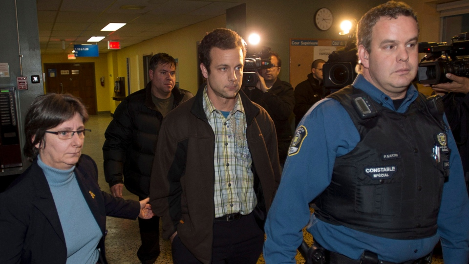 Patrick Desautels, centre, arrives for the arraignment of his wife, Sonia Blanchette, on charges in the deaths of their three children, at the courthouse in Drummondville, Que., Wednesday, Dec. 5, 2012. (Ryan Remiorz / THE CANADIAN PRESS)