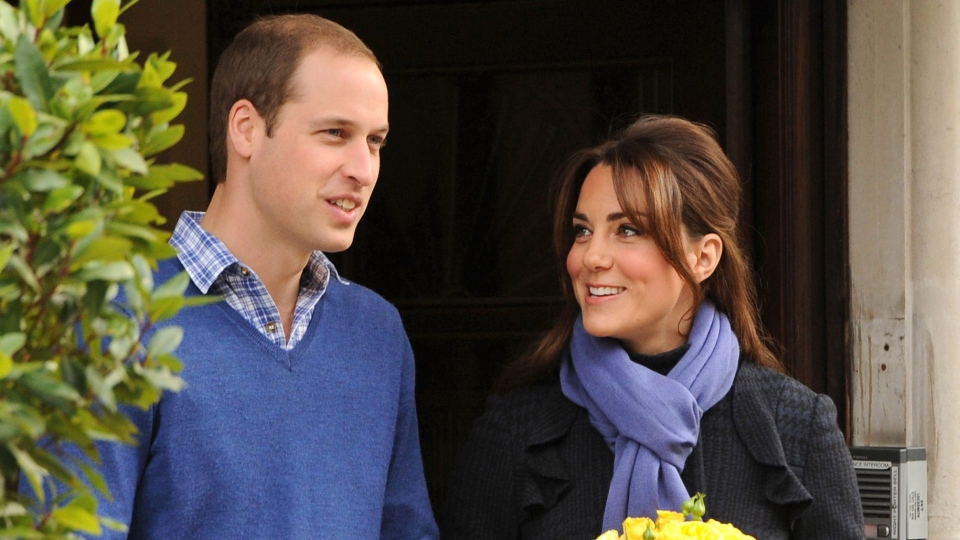 Prince William stands next to his wife Kate, Duchess of Cambridge as she leaves the King Edward VII hospital in central London, Thursday, Dec. 6, 2012. (AP / Andrew Matthews)