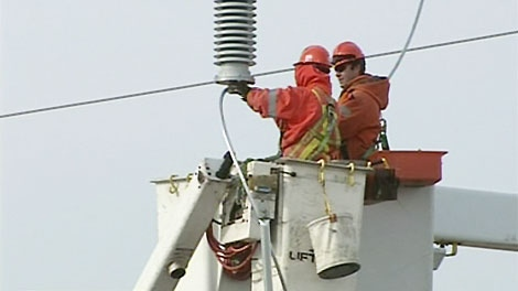 Workers with Kitchener Wilmot Hydro work to build a new transformer near Baden, Ont. on Tuesday, Nov. 23, 2010.