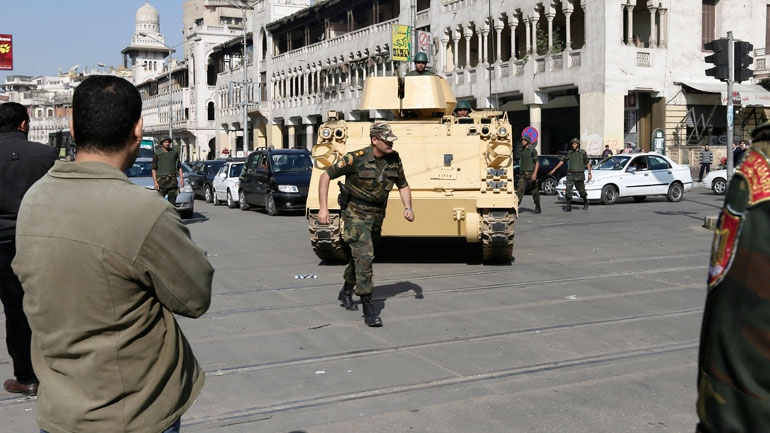 Egyptian Army soldiers deploy near the presidential palace to secure the site of overnight clashes between supporters and opponents of President Mohammed Morsi in Cairo, Egypt, Thursday, Dec. 6, 2012. (AP / Hassan Ammar)
