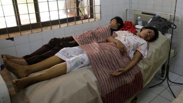 Survivors of Monday's stampede lie on a bed at Preah Kossamak Hospital in Phnom Penh, Cambodia, Wednesday, Nov. 24, 2010. (AP / Sakchai Lalit)