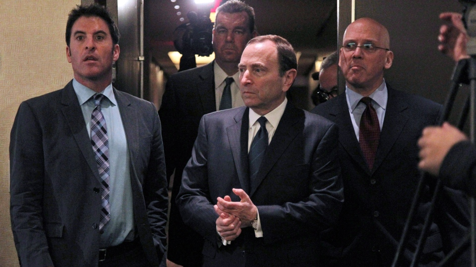 NHL commissioner Gary Bettman, centre, arrives to speak with reporters after an NHL Board of Governors meeting in New York, Wednesday, Dec. 5, 2012. (AP / Mary Altaffer)