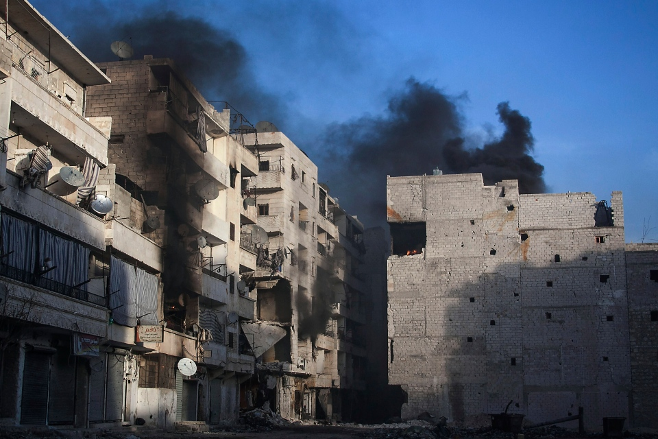 Smoke rises from residential buildings due heavy fighting between Free Syrian Army fighters and government forces in Aleppo, Syria Wednesday, Dec. 5, 2012. (AP / Narciso Contreras)