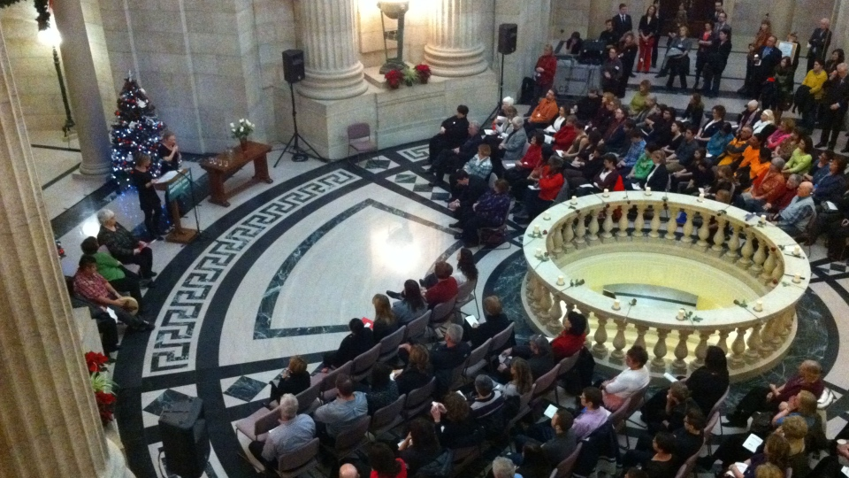 People gathered to remember female victims of violence at the legislative rotunda Thursday morning.