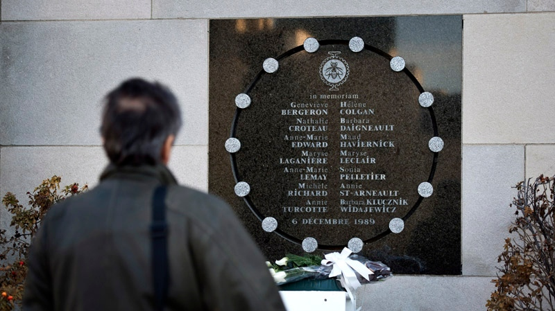 A man stands in front of the commemorative plaque at the University of Montreal on the 23rd anniversary of the Polytechnique massacre, where 14 women students were killed by a lone gunman in 1989, in Montreal, Thursday, Dec. 6, 2012. (THE CANADIAN PRESS / Paul Chiasson)