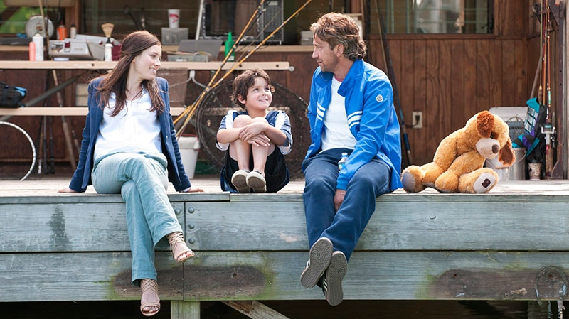 Jessica Biel, Noah Lomax, and Gerard Butler in a scene from VVS Films' 'Playing for Keeps'