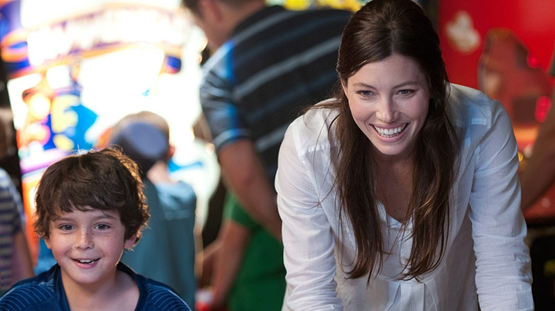 Jessica Biel, right, and Noah Lomax in a scene from VVS Films' 'Playing for Keeps'