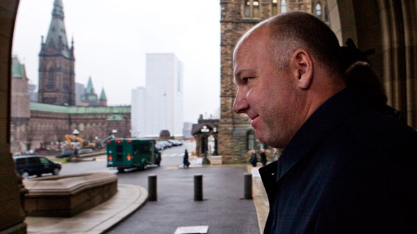 Montreal construction boss Paul Sauve leaves the centre block in view of the west block after appearing as a witness at the Commons government operations committee regarding the West Block contract on Parliament Hill in Ottawa on Tuesday, Nov. 23, 2010. (Sean Kilpatrick /  THE CANADIAN PRESS)