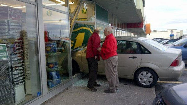 car crashes through Dollarama