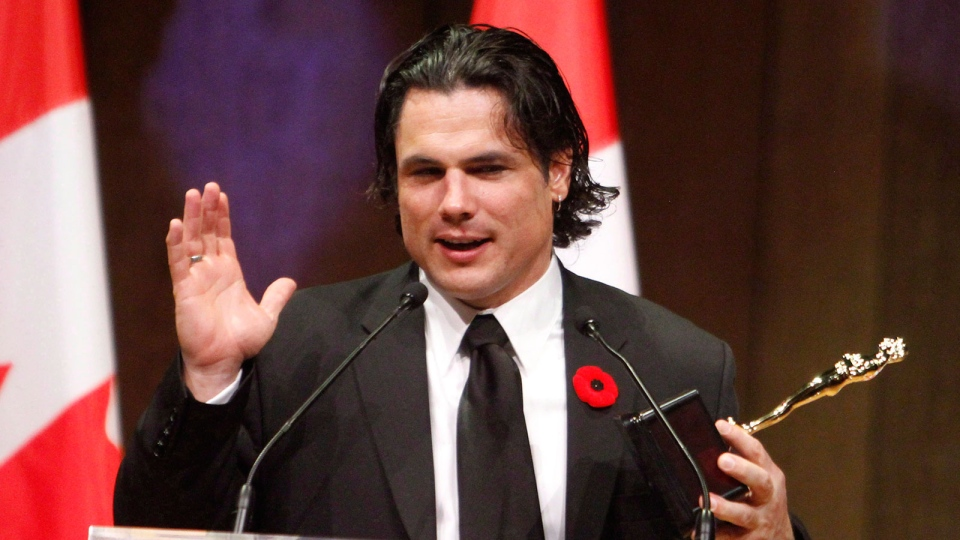 Sen. Patrick Brazeau accepts the Bad Sport Award at the National Press Gallery Dinner Saturday in Gatineau, Quebec, Saturday, Nov. 3, 2012. (Fred Chartrand / THE CANADIAN PRESS)