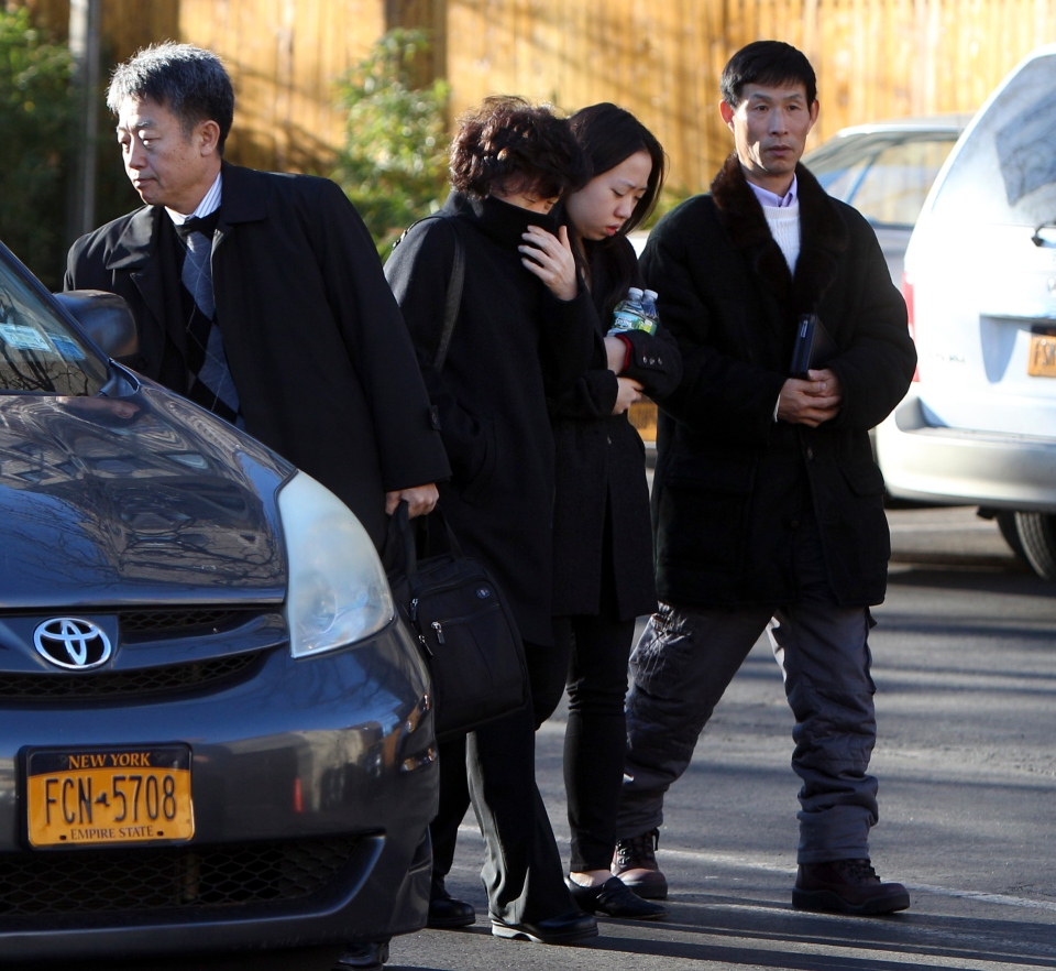 Ki-Suck Han's daughter Ashley Han, second from right, and wife Serim Hanin, second from left, arrive for his memorial service in New York, Thursday, Dec. 6, 2012. (AP / Seth Wenig)