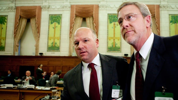 Montreal construction boss Paul Sauve, middle, leaves committee after appearing as a witness at the Commons government operations committee regarding the West Block contract on Parliament Hill in Ottawa on Tuesday, Nov. 23, 2010. (Sean Kilpatrick / THE CANADIAN PRESS)