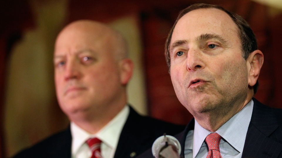 NHL commissioner Gary Bettman, right, and deputy commissioner Bill Daly and speak to reporters in New York on Thursday, Dec. 6, 2012. (AP / Mary Altaffer)