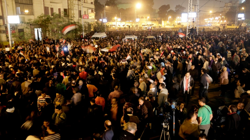 Egyptian protesters chant anti Muslim Brotherhood and Egyptian President Morsi slogans outside the presidential palace in Cairo, Egypt, Thursday, Dec. 6, 2012. (AP / Hassan Ammar)