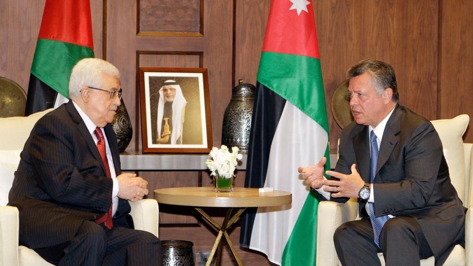 King Abdullah II of Jordan, right, receives Palestinian President Mahmoud Abbas in Amman, Jordan, Sunday, Dec. 2, 2012. (AP / Raad Adayleh)