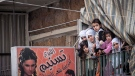 In this Friday, Nov. 30, 2012 photo, Syrian women and children watch a demonstration after Friday prayers in the Bustan Al-Qasr district of Aleppo, Syria.  (AP Photo/Narciso Contreras)