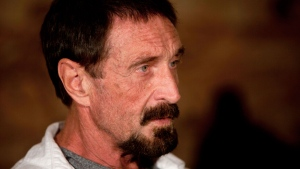 Software company founder John McAfee listens to a question during an interview at a local restaurant in Guatemala City, Tuesday, Dec. 4, 2012. (AP / Moises Castillo)